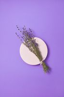 Organic lavender bunch on a ceramic plate.