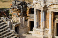 Antique columns and arches in the Hierapolis amphitheater.