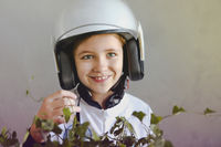 Astronaut futuristic kid girl wearing white uniform and helmet