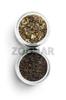Dried black and green tea leaves.