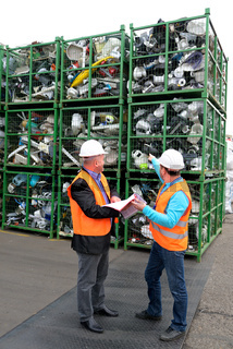 Bucharest, Romania - October 2013: Managers of a recycling plant discuss the plan about how to organize the electronic waste on a recycling plant site