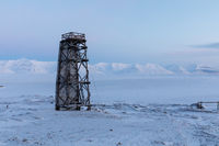 Tower by the frozen sea, winter landscape at Pyramiden, Svalbard.