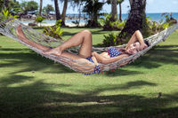 Woman is resting in the hammock
