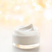 Facial cream moisturizer jar on holiday glitter background, moisturizing skin care as lifting emulsion, anti-age cosmetics for luxury beauty skincare brand