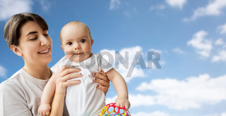 happy young mother holding little baby daughter