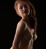 Erotica. Sensual babe posing seminude at camera