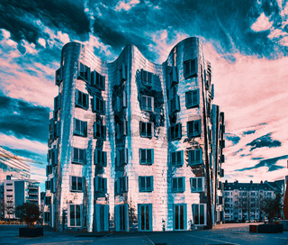 DUESSELDORF, GERMANY - JANUARY 20, 2017: One of the famous Ghery-Buildings in the New Media Harbor contrasts with the vivid sky in colour
