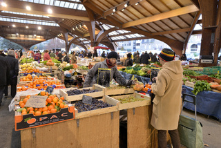Food Market in France early morning with clients