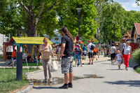 People near playground Budapest Zoo filling a bottle of water