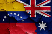 flags of Venezuela and Australia painted on cracked wall