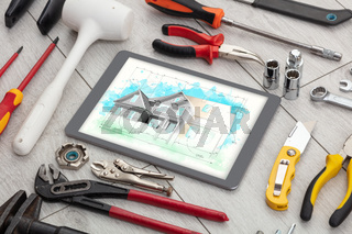 Tablet and tools with house plan concept