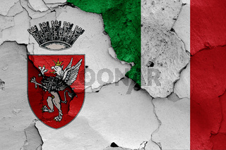 flags of Perugia and Italy painted on cracked wall