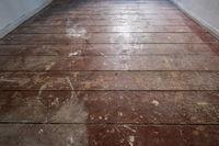 old wooden floor / floorboards in old apartment room - construction concept
