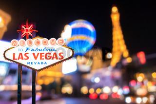 Famous Las Vegas sign with blur cityscape