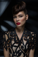 beautiful young woman with fancy hairdo and red lips