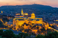 Aerial view illuminated Budapest Castle at sunset in Hungary