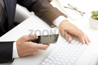 Business man using modern smartphone