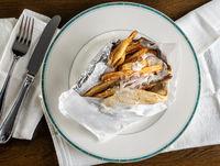 Flat lay of Greek chicken souvlaki gyro take out food arranged on plate