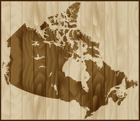 Vector illustration Canada map on wood background