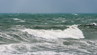 Rough sea by a stormy weather day