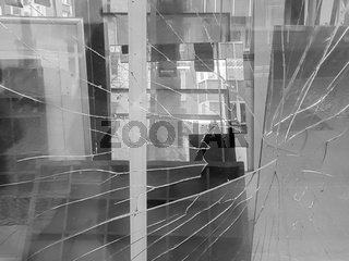 A broken glass of a window with many glass plates in the background