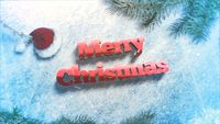 Closeup Merry Christmas text, green tree branches on snow background