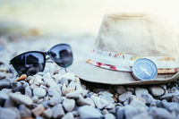 Summer holiday concept. Straw hat and accessories on the beach. Italy.