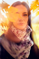 Beautiful romantic girl in a park autumn scenery. Gorgeous young woman outdoors. Close-up shot portrait in natural light, double exposure and soft focus, retouched, vibrant colors