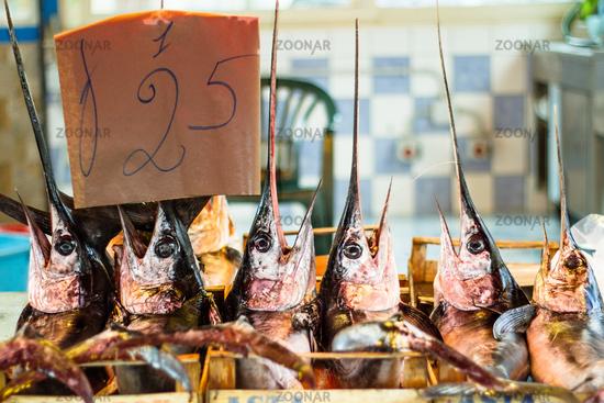 Fresh swordfish being sold at the sicilian fish market