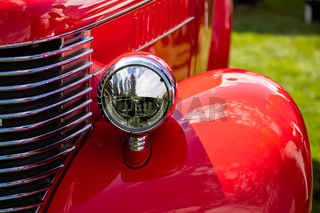 Antique American red pickup car front