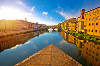 Ponte Vecchio bridge and Florence waterfront sunrise view