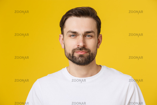 Young casual man portrait isolated on yellow background