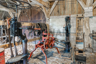 Dutch rural open-air museum with smithy and old historical machinery