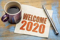 welcome 2020 on napkin with coffee
