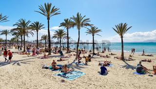 People sunbathing on the beach of El Arenal town,  Majorca, Baleares, Spain