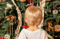 Young child looking at their first Christmas Tree in wonder and amazement