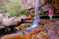 Woman hiker at Cachoeira Da Primavera, Spring Waterfall, Rio Lencois river, Chapada Diamantina National Park, Brazil