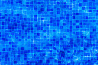 Abstract texture of tiles in a pool. Distorted through ripples.