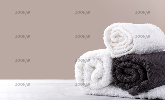 White and beige soft rolled cotton towels