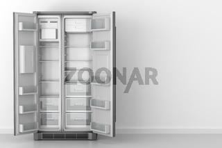 modern empty fridge in front of white wall