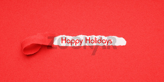 happy holidays peel away red paper background to reveal christmas greeting