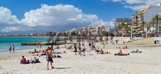 People sunbathing on the beach of El Arenal resort town,  Majorca, Baleares, Spain