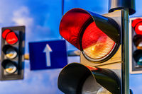 Traffic lights over urban intersection. Red light
