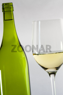 white wine bottle with a glass