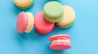 French macaroons on blue background, parisian chic cafe dessert, sweet food and cake macaron for luxury confectionery brand, holiday backdrop design