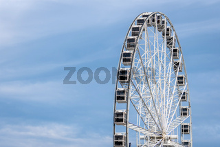 Panoramic wheel on a light blue sky background