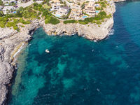 Coast of Porto Cristo with villas and natural harbor
