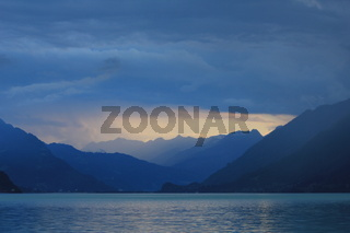 Summer scene at Lake Brienz. Last sunlight of the day and thunderstorm over Interlaken, Switzerland.