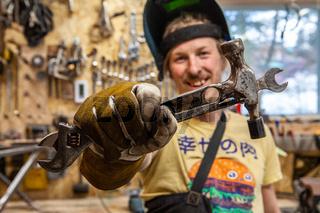 Blacksmith shows tools inside garage