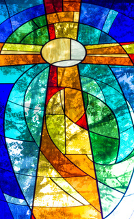 Stained glass cross in bright vivid colors